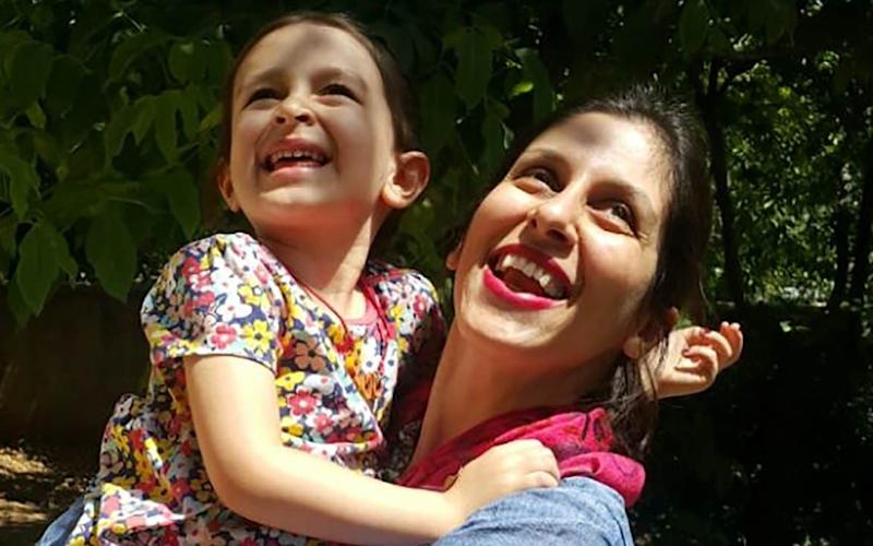 Nazanin Zaghari-Ratcliffe, seen here with her daughter Gabriella, has been held in Tehran since 2016 - AFP