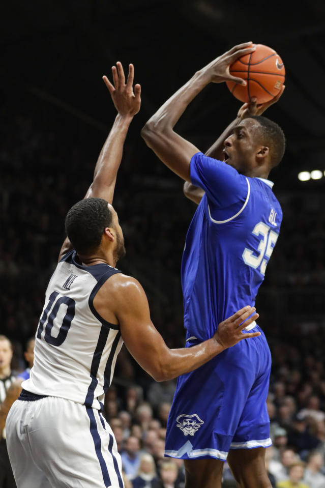 Seton Hall center Romaro Gill (35) shoots over Butler forward Bryce Nze (10) in the second half of an NCAA college basketball game in Indianapolis, Wednesday, Jan. 15, 2020. Seton Hall defeated Butler 78-70. (AP Photo/Michael Conroy)
