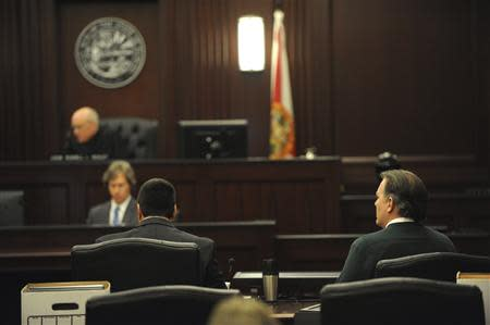 Michael Dunn (R), who faces first-degree murder charges in the death of 17-year-old Jordan Davis, sits with his attorney Cory Strolla while Judge Healey addresses the jury at Duval County Courthouse in Jacksonville, Florida February 6, 2014. REUTERS/Bob Mack/The Florida Times-Union/Handout