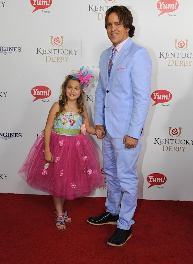 Larry Birkhead, right, and his daughter Dannielynn are photographed at the 140th Kentucky Derby Saturday, May 3, 2014 in Louisville Ky. (Photo by Joe Imel/Invision/AP)