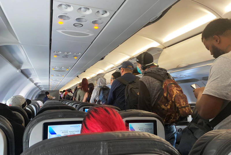 Virus Outbreak-Crowded Planes-Q&A