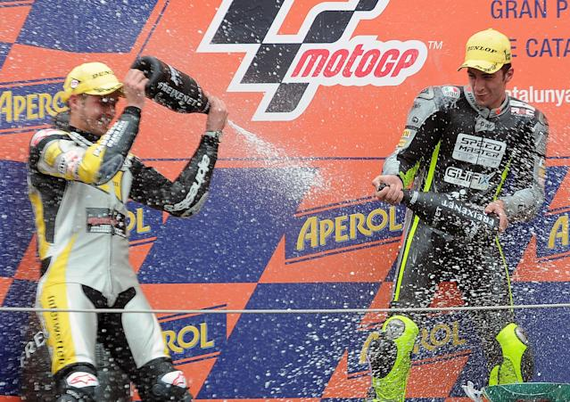 Speed Master's Italian Andrea Iannone (R) and Interwetten Paddock Moto2's Swiss Thomas Luthi (L) celebrate on the podium after the Moto2 race of the Catalunya Moto GP Grand Prix at the Catalunya racetrack in Montmelo, near Barcelona, on June 3, 2012. Speed Master's Italian Andrea Iannone won the race ahead of Interwetten-Paddock's Swiss Thomas Luthi and Team CatalunyaCaixa Repsol 's Spanish Marc Marquez. AFP PHOTO / LLUIS GENELLUIS GENE/AFP/GettyImages