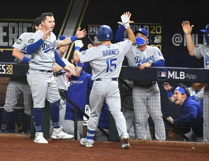 Dodgers manager Dave Roberts, right, greets Austin Barnes after Barnes homered in Game 3 of the World Series.