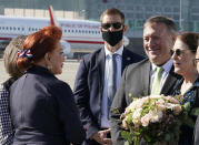 US Secretary of State Mike Pompeo, second right, and his wife Susan talk with US Ambassador to Poland Georgette Mosbacher, left, as they arrive at the airport in Warsaw, Poland, Saturday Aug. 15, 2020. Pompeo is on a five day visit to central Europe. (Janek Skarzynski/Pool via AP)