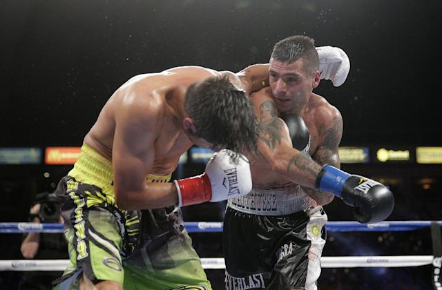 Lucas Matthysse, right, of Argentina, lands a punch to the face of John Molina Jr. during the eighth round of a junior welterweight boxing match Saturday, April 26, 2014, in Carson, Calif. Matthysse won by knockout in the 11th round. (AP Photo/Jae C. Hong)