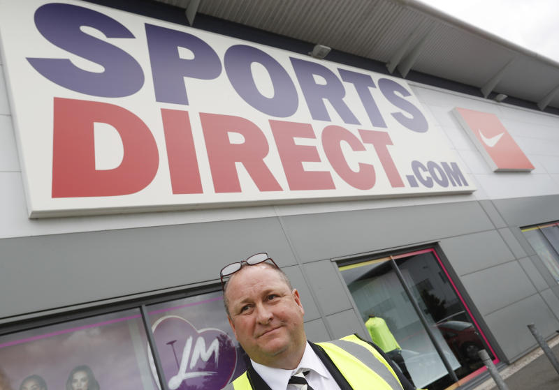 Mike Ashley (C), founder and majority shareholder of sportwear retailer Sports Direct, leads journalists on a factory tour after the company's AGM, at the company's headquarters in Shirebrook, Britain, September 7, 2016. REUTERS/Darren Staples
