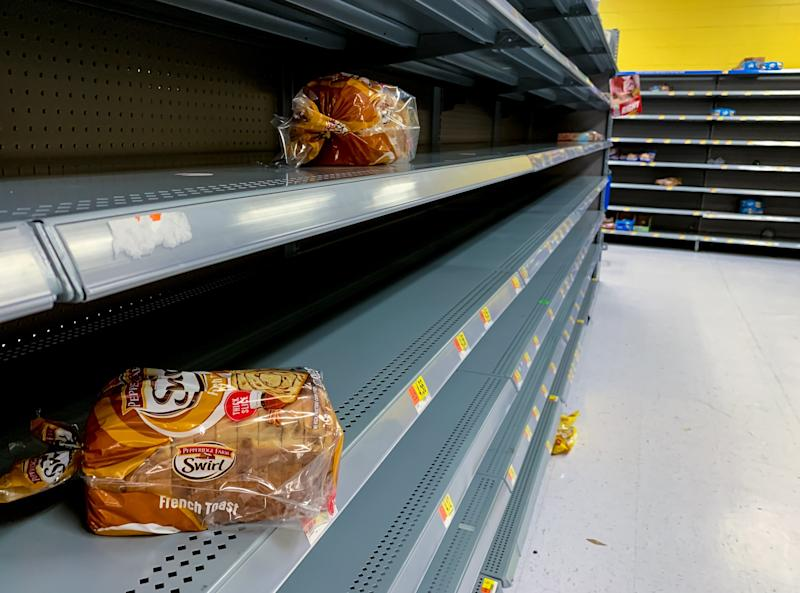 A few loaves remain in the bread isles after customers prepare for hurricane Dorian inside the Walmart on Indiantown Road in Jupiter, Fla. on Aug. 29, 2019. (Photo: Richard Graulich/The Palm Beach Post via ZUMA Wire)
