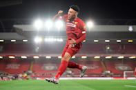 Liverpool midfielder Alex Oxlade-Chamberlain celebrates scoring his team's final goal against Chelsea. (PHOTO: Laurence Griffiths/POOL/AFP via Getty Images)