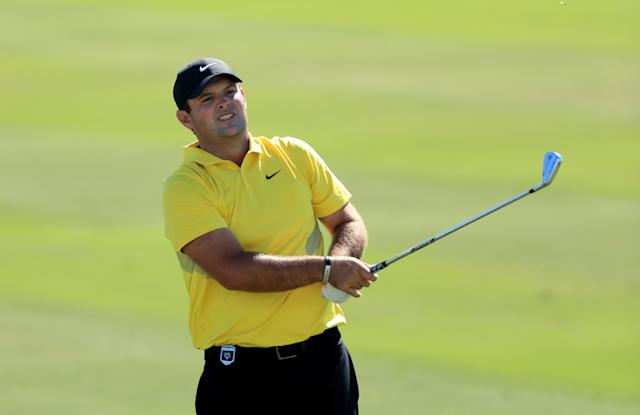 After cameras caught him blatantly improving his line of play in a bunker at the Hero World Challenge, Patrick Reed was hit with a two-shot penalty. (David Cannon/Getty Images)