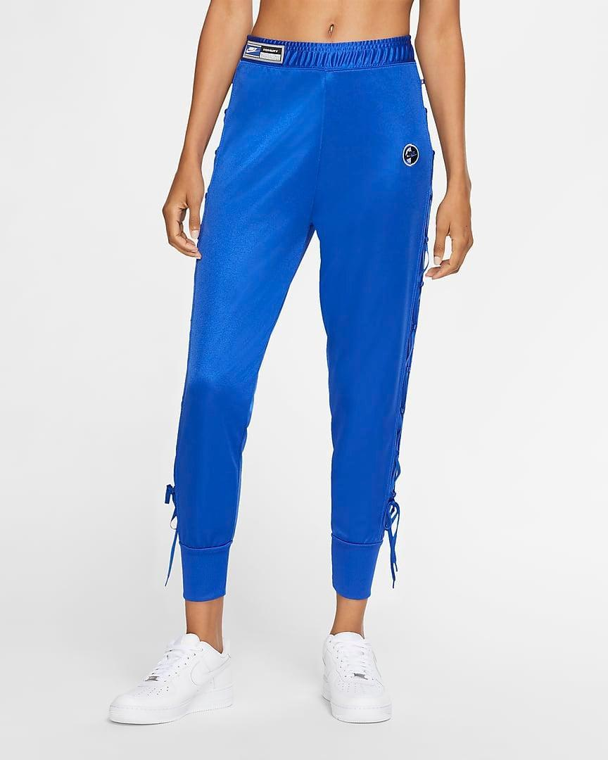 "<br><br><strong>Nike</strong> Pants, $, available at <a href=""https://go.skimresources.com/?id=30283X879131&url=https%3A%2F%2Fwww.nike.com%2Ft%2Fsportswear-womens-pants-0nBc9f%2FCU6793-405"" rel=""nofollow noopener"" target=""_blank"" data-ylk=""slk:Nike"" class=""link rapid-noclick-resp"">Nike</a>"