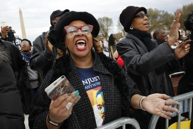 "<p>Wearing a t-shirt of Martin Luther King, Jr., Debra Payne, of Kansas City, Missouri, sings ""This Little Light of Mine,"" next to Jo-Lynn Gilliam, of East Point, Ga., as they attend the A.C.T. To End Racism rally, Wednesday, April 4, 2018, on the National Mall in Washington, on the 50th anniversary of Martin Luther King, Jr.'s assassination. (Photo: Jacquelyn Martin/AP) </p>"