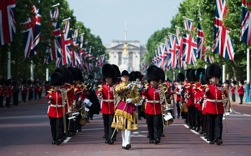 The Household Division march down the Mall, ahead of the Trooping the Colour ceremony [Photo: PA]