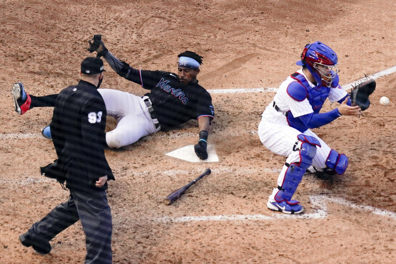 The Marlins slid past the Cubs in Game 2 of the NL wild-card series. (Photo by Nuccio DiNuzzo/MLB Photos via Getty Images)