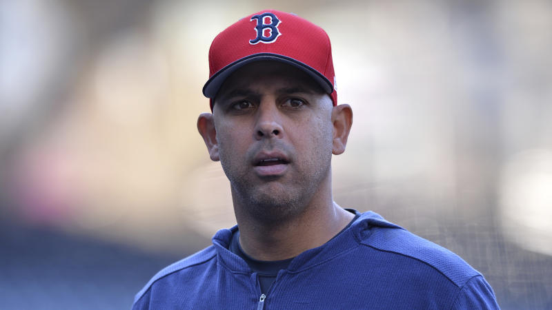 Boston Red Sox' Alex Cora looks on before the baseball game against the San Diego Padres Friday, Aug. 23, 2019, in San Diego. (AP Photo/Orlando Ramirez)