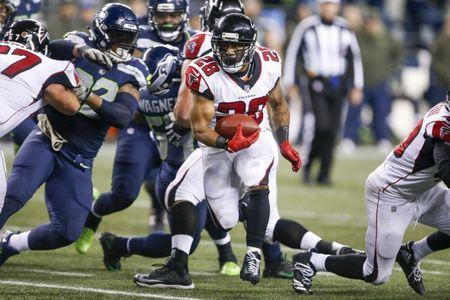 Nov 20, 2017; Seattle, WA, USA; Atlanta Falcons running back Terron Ward (28) rushes against the Seattle Seahawks during the fourth quarter at CenturyLink Field. Joe Nicholson-USA TODAY Sports