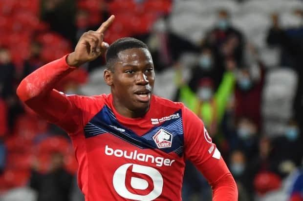 Rising Canadian soccer star Jonathan David scored one goal and helped set up the other Sunday as Lille sealed the French Ligue 1 title with a 2-1 victory over Angers. (AFP via Getty Images - image credit)
