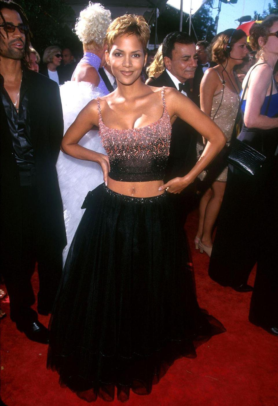 <p>Halle showed up to the Emmy Awards in an embellished crop top and maxi skirt, proving that, yes, you can bare your midriff at a fancy event! </p>