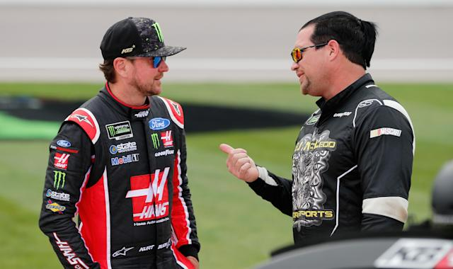 B,J. McLeod (R) talks to 2004 Cup Series champion Kurt Busch. McLeod owns two cars in NASCAR's No. 2 series. (Getty Images)