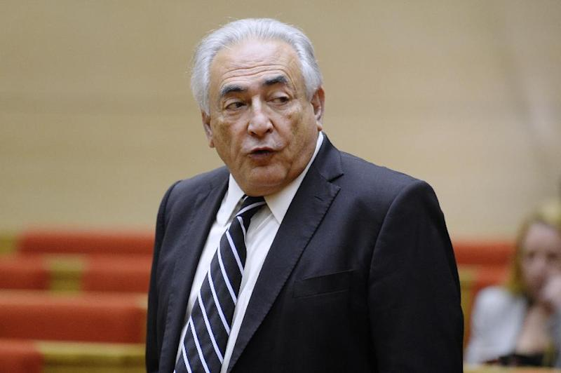 """Ex-IMF chief Dominique Strauss-Kahn, seen here in 2013, goes on trial charged with """"pimping"""""""