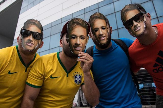 Fans wear masks of Brazil's Neymar, who is home with his famous right foot recovering from surgery as the rest of the Brazil squad prepare to face hosts Russia in their penultimate World Cup warmup (AFP Photo/Nelson ALMEIDA)