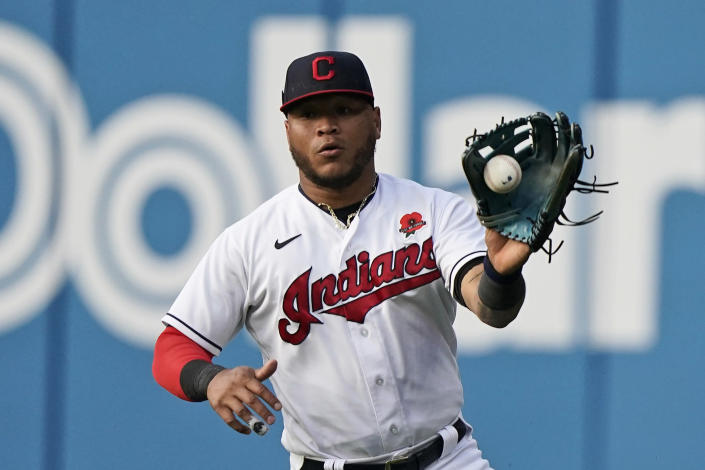 Cleveland Indians' Harold Ramirez fields a ball hit by Chicago White Sox's Nick Madrigal in the third inning of the second baseball game of a doubleheader, Monday, May 31, 2021, in Cleveland. Madrigal was safe at first base for a single. (AP Photo/Tony Dejak)