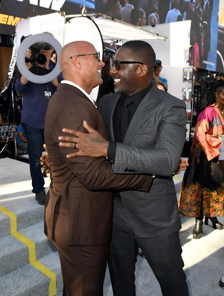 <p>Dwayne Johnson and Idris Elba shared a friendly hug at the LA premiere of <strong>Hobbs and Shaw</strong> in July 2019.</p>