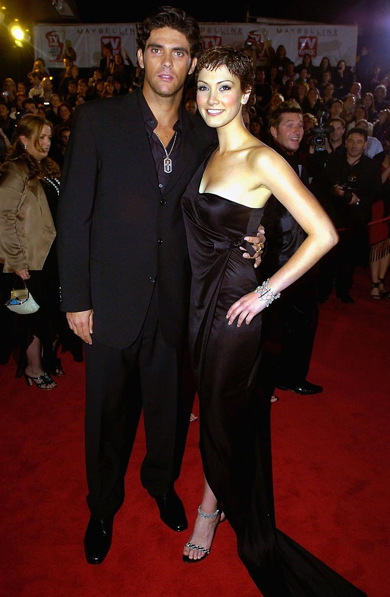 Mark Philippoussis and Delta Goodrem both wear black outfits on the red carpet at the 46th Annual TV Week Logie Awards at the Crown Entertainment Complex April 18, 2004 in Melbourne, Australia.