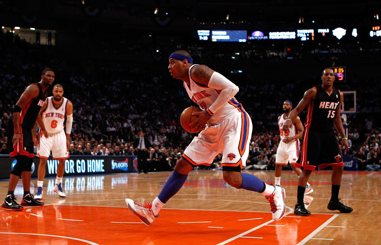 NEW YORK, NY - MAY 03:  Carmelo Anthony #7 of the New York Knicks drives in the first quarter against the Miami Heat in Game Three of the Eastern Conference Quarterfinals in the 2012 NBA Playoffs on May 3, 2012 at Madison Square Garden in New York City.  NOTE TO USER: User expressly acknowledges and agrees that, by downloading and or using this photograph, User is consenting to the terms and conditions of the Getty Images License Agreement.  (Photo by Jeff Zelevansky/Getty Images)
