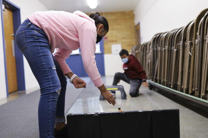 Aylin Garcia Rosa, 9, attempts to get the car she built with her cousin down a ramp and through a