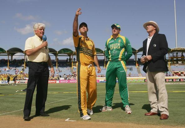 GROS ISLET, SAINT LUCIA - APRIL 25: Ricky Ponting of Australia tosses the coin watched by Graeme Smith of South Africa, commentator Barry Richards and match referee Jeff Crowe during the ICC Cricket World Cup Semi Final match between Australia and South Africa at the Beausejour Cricket Ground on April 25, 2007 in Gros Islet, Saint Lucia. (Photo by Hamish Blair/Getty Images)