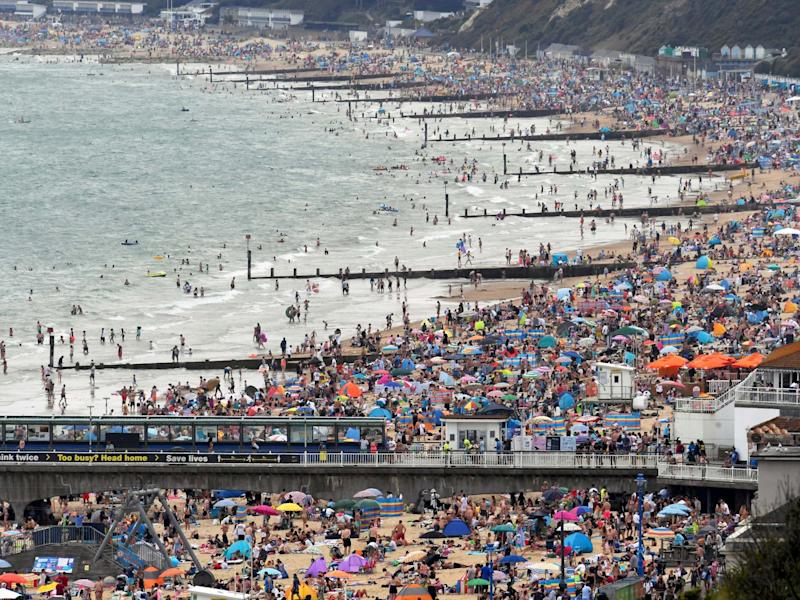 People enjoy the sunny weather at the Bournemouth Beach, amid the coronavirus disease (COVID-19) outbreak, in Bournemouth: Reuters