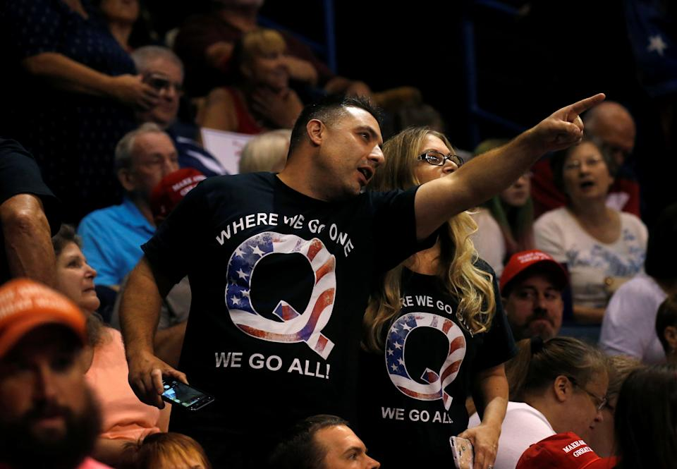 Supporters wearing shirts with the QAnon logo, chat before U.S. President Donald Trump takes the stage during his Make America Great Again rally in Wilkes-Barre, PA. REUTERS/Leah Millis