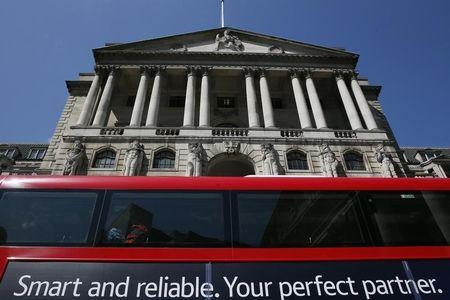 A bus passes the Bank of England in London
