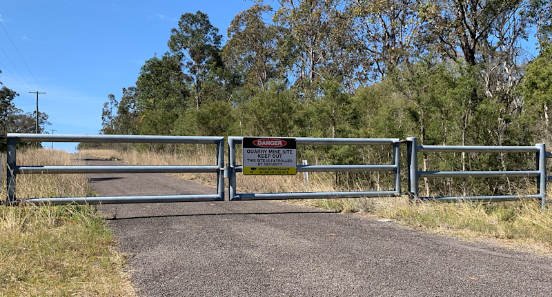 Locked gates at the entrance to the Brandy Hill quarry. Source: Michael Dahlstrom