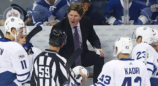 Toronto Maple Leafs head coach Mike Babcock has words with an official for an illegal equipment penalty. (John Woods/CP)