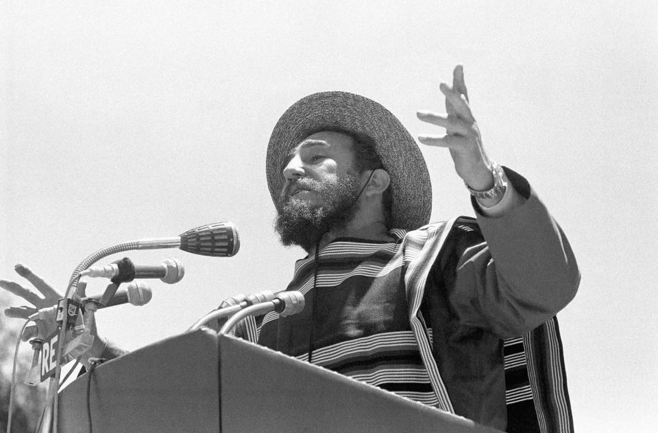 <p>Cuba's Fidel Castro visited this small farming town, Santa Cruz, Chile Nov. 25, 1971 where he delivered a speech clad in a typical Chilean Huaso poncho and featuring a strawhat. Later he went to an outdoor luncheon at the Las Palmas agrarian reform center where he spoke to newsmen on the relation between US and Cuba. Castro during his speech. (AP Photo) </p>