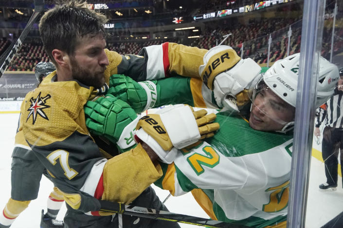 Vegas Golden Knights defenseman Alex Pietrangelo (7) and Minnesota Wild left wing Kevin Fiala (22) fight during the third period of an NHL hockey game Wednesday, March 3, 2021, in Las Vegas. (AP Photo/John Locher)