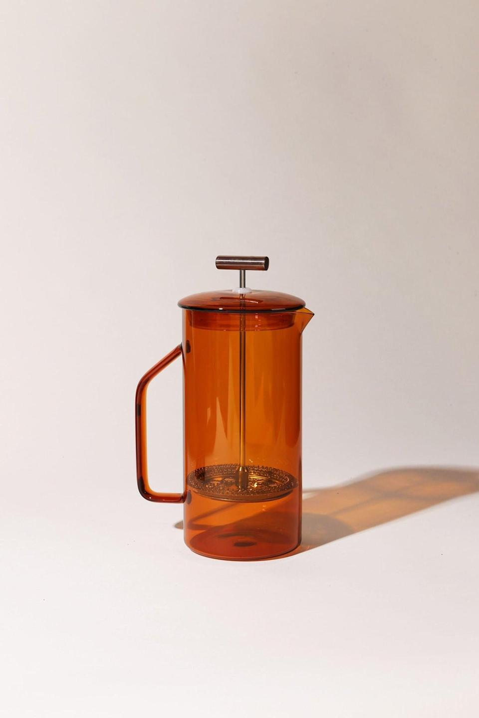 <p>This <span>YieldDesignCo Glass French Press</span> ($85) looks so good, they'll have it on display long after they finish using it. From the color to the compact size, it's perfect.</p>