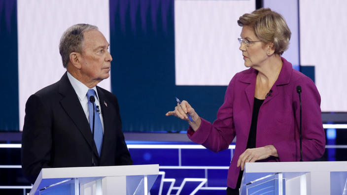 Michael Bloomberg and Elizabeth Warren face off at the debate on Wednesday night. (John Locher/AP)