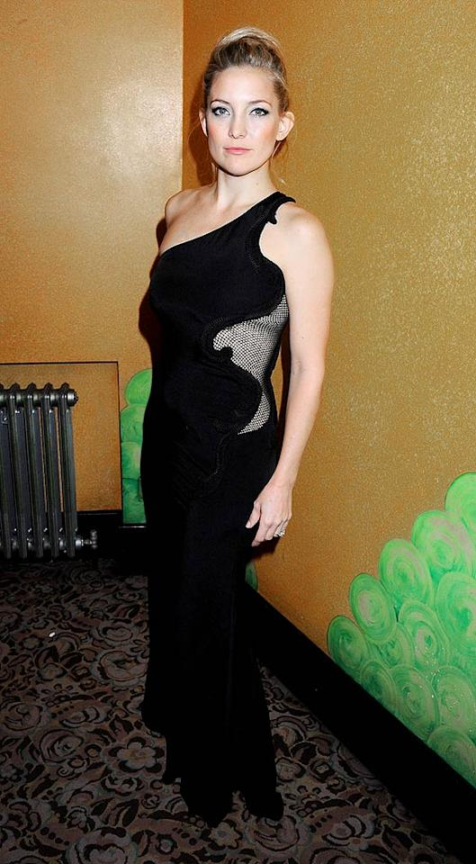 Kate Hudson -- who gave birth to son Bingham almost five months ago -- was also in attendance at the event looking slender and stunning in a black velvet one-shoulder dress featuring a mesh panel from Stella McCartney's spring 2012 collection. (11/28/2011)