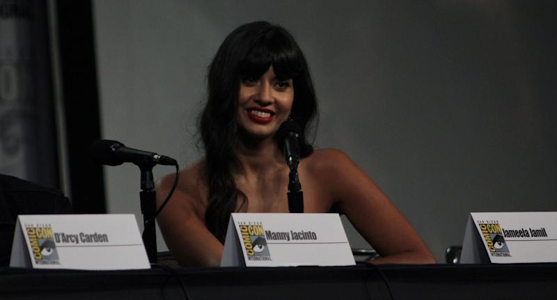 During an interview, Jameela Jamil shares a contagious smile