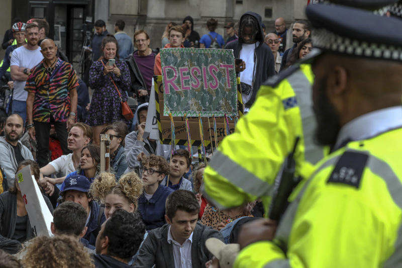 Police stand guard in Trafalgar Square, London, Saturday, Aug. 31, 2019, as anti-Brexit protestors gather. Political opposition to Prime Minister Boris Johnson's move to suspend Parliament is crystalizing with protests around Britain and a petition to block the move gaining more than 1 million signatures. (AP Photo/Vudi Xhymshiti)