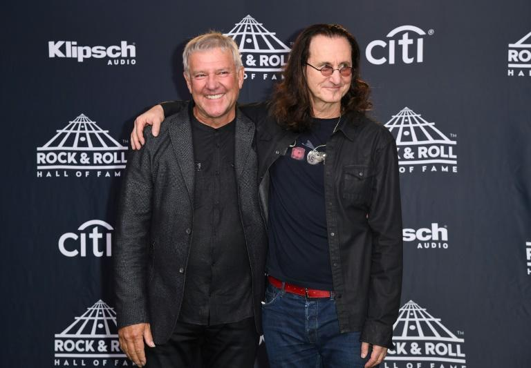 Inductees Alex Lifeson (L) and Geddy Lee of RUSH pose at the 31st Annual Rock And Roll Hall of Fame Induction Ceremony at Barclays Center in New York City