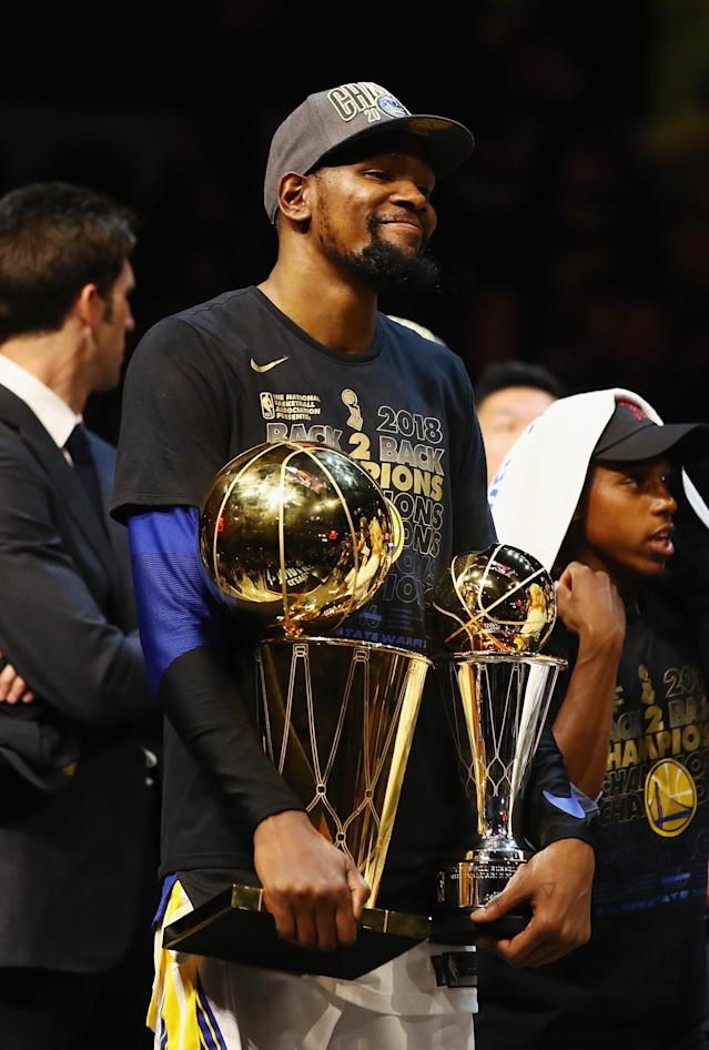 CLEVELAND, OH - JUNE 08: Kevin Durant #35 of the Golden State Warriors celebrates with the Larry O'Brien Trophy and MVP Trophy after defeating the Cleveland Cavaliers during Game Four of the 2018 NBA Finals at Quicken Loans Arena on June 8, 2018 in Cleveland, Ohio. The Warriors defeated the Cavaliers 108-85 to win the 2018 NBA Finals. (Photo by Gregory Shamus/Getty Images)