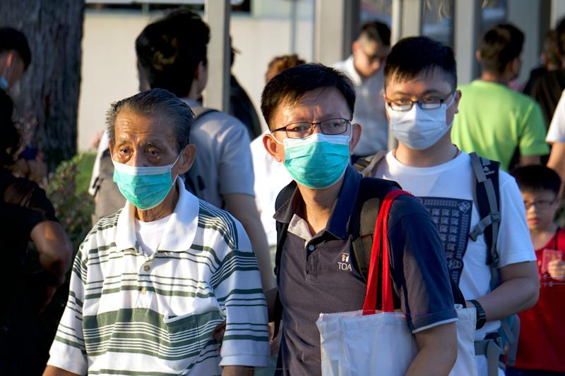 People wearing masks seen outside the Woodlands Checkpoint on 17 March 2020. (PHOTO: Dhany Osman / Yahoo News Singapore)