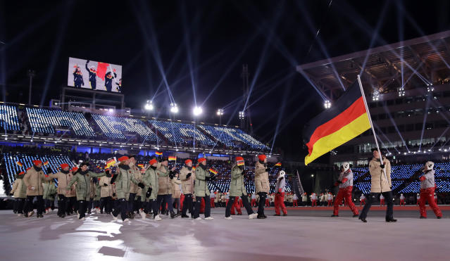 <p>Eric Frenzel carries the flag of Germany during the opening ceremony of the 2018 Winter Olympics in Pyeongchang, South Korea, Friday, Feb. 9, 2018. (AP Photo/Vadim Ghirda) </p>