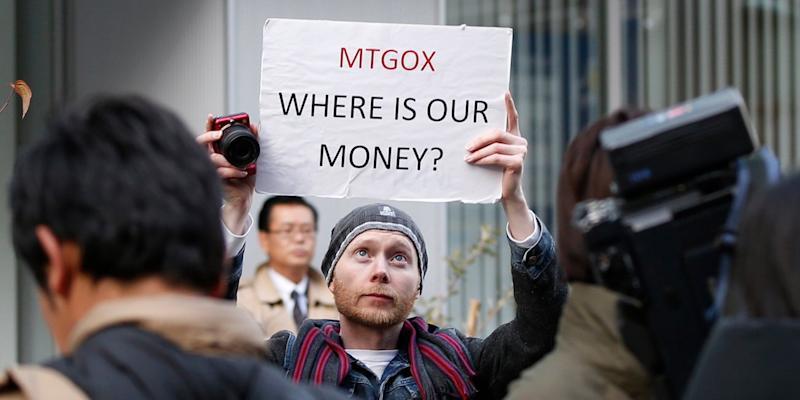 Kolin Burges, a self-styled cryptocurrency trader and former software engineer from London, holds up a placard to protest against Mt. Gox, in front of the building where the digital marketplace operator was formerly housed in Tokyo February 26, 2014. Japanese authorities are looking into the abrupt closure of Mt. Gox, the top government spokesman said on Wednesday in Tokyo's first official reaction to the turmoil at what was the world's biggest exchange for bitcoin virtual currency.