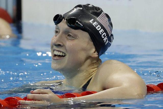 """<a class=""""link rapid-noclick-resp"""" href=""""/olympics/rio-2016/a/1119883/"""" data-ylk=""""slk:Katie Ledecky"""">Katie Ledecky</a> smiles after winning gold in the 200 freestyle on Tuesday. (AP)"""