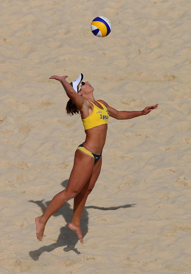 LONDON, ENGLAND - JULY 30: Larissa Franca of Brazil serves during the Women's Beach Volleyball Preliminary match between Germany and Brazil on Day 3 of the London 2012 Olympic Games at Horse Guards Parade on July 30, 2012 in London, England. (Photo by Ryan Pierse/Getty Images)