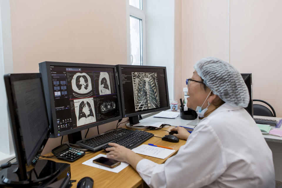 A medical worker looks at a computer tomography examination of patients suspected of having coronavirus at the hospital in Ulan-Ude, the regional capital of Buryatia, a region near the Russia-Mongolia border, Russia, Friday, Nov. 20, 2020. Russia's health care system has been under severe strain in recent weeks, as a resurgence of the coronavirus pandemic has swept the country. (AP Photo/Anna Ogorodnik)
